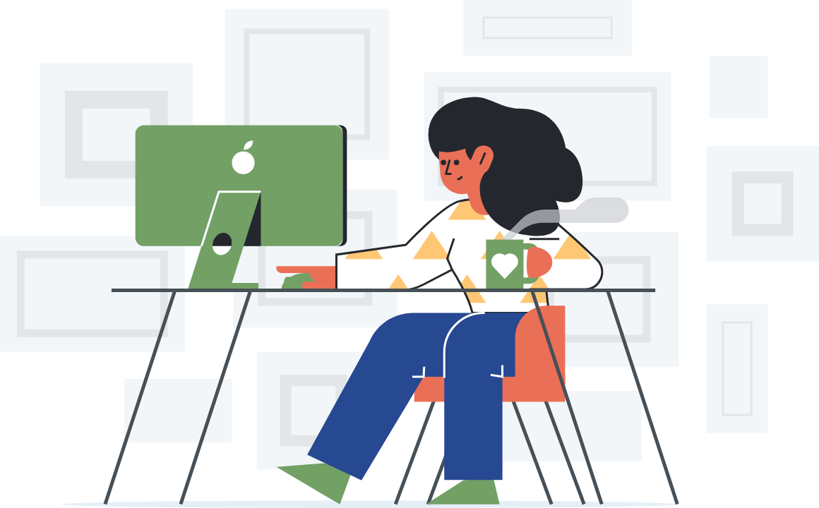 a smiling girl sitting and working on her computer drinking her cup with heart
